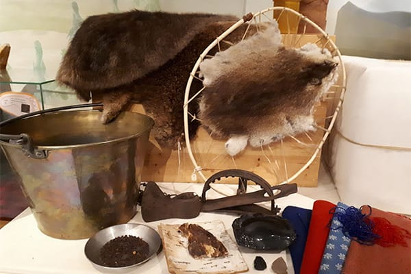 hands on fur trade materials - river of memory exhibit